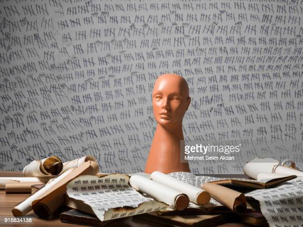 Plastic Mannequin Head And Antique Books On Desk