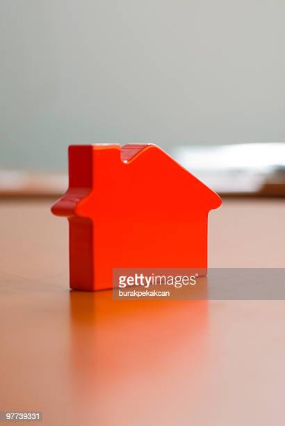 plastic miniature-house standing on a table, selective focus