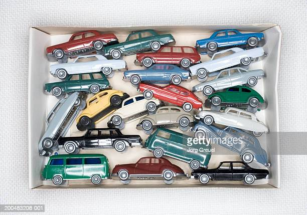 Plastic model cars in cardboard box