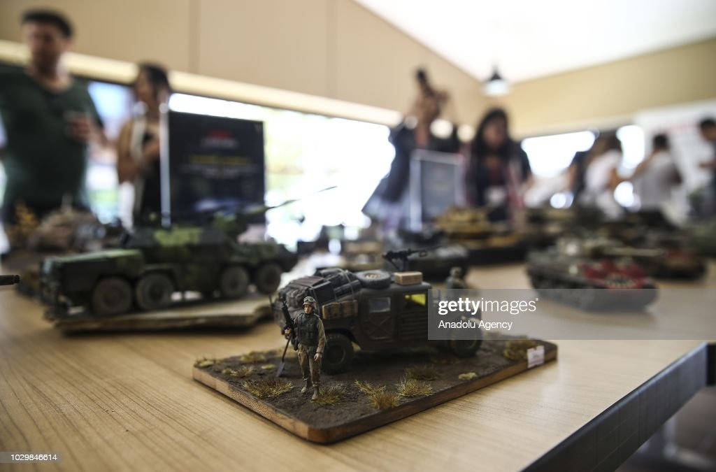 A plastic model of a military tank is displayed at FNSS