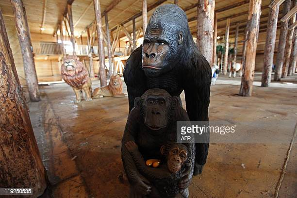 Plastic monkeys are seen on the 150 metrelong Noah's ark created by Dutch Johan Huibers at an old abandoned quay on the Merwede River in Dordrecht on...