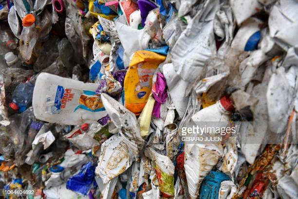 Plastic packaging are seen in the courtyard of a MP Industries waste recycling plant in Gardanne, near Marseille, on November 23 during the launch of...