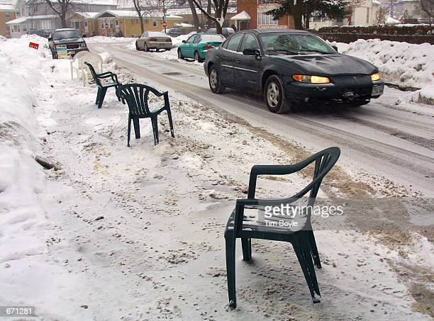Plastic patio chairs protect residents'' cleared parking spots December 20 2000 on a snowy street in Chicago IL For years residents in neighborhoods...