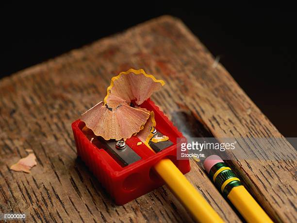 Plastic pencil sharpener, with pencil and shavings