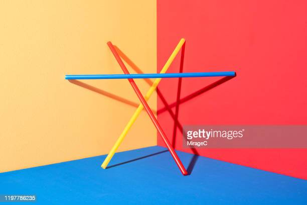 plastic pipe triangle structure - stability stock pictures, royalty-free photos & images