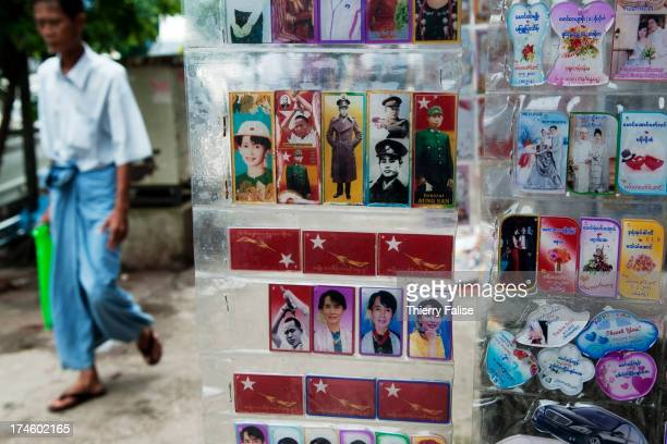 Plastic plates bearing portraits of Aung San Suu Kyi and her father Aung San founder of the country's independence are sold in a Yangon street