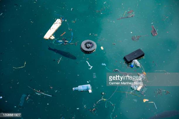 plastic pollution in ocean problem. - water pollution stock pictures, royalty-free photos & images