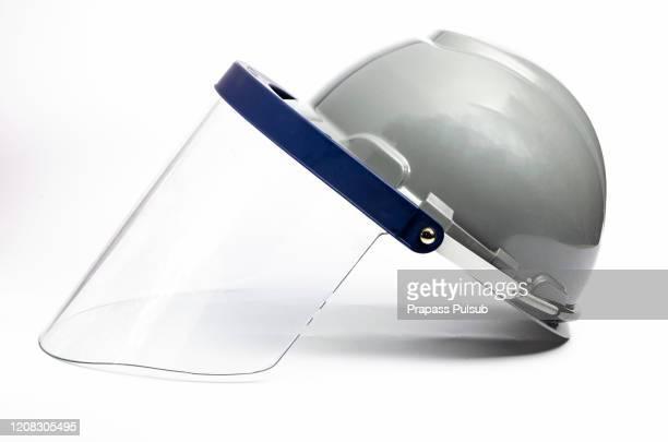 plastic protective face shield. isolated on white background - フェイスシールド ストックフォトと画像