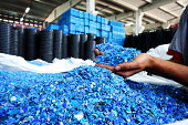 Plastic Resin pellets in holding hands