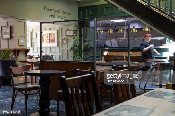 Plastic screens are installed at a branch of Weatherspoons in Muswell Hill as it prepares for reopening on June 25 2020 in London United Kingdom...
