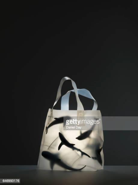 Plastic sea life creatures in plastic bag filled with plastic cups