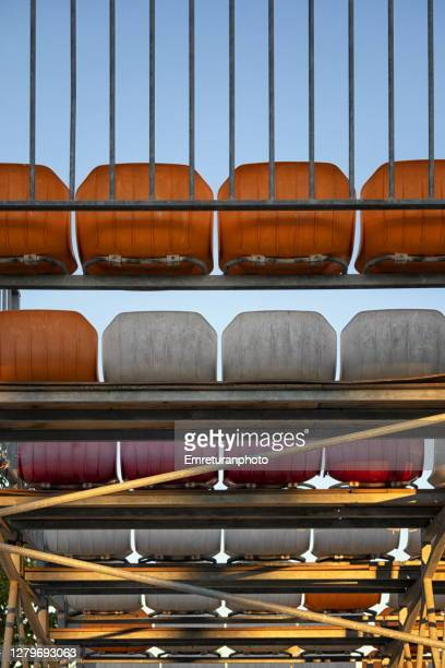 plastic seats seen from below - emreturanphoto stock pictures, royalty-free photos & images