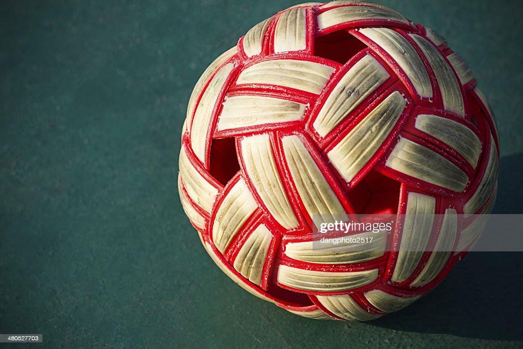 Plastic Sepak takraw ball on the cement floor. : Stock Photo