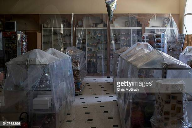 Plastic sheeting is seen covering souvenirs at the gift shop at the closed Imperial Marhaba Hotel on June 24 2016 in Sousse Tunisia The Imperial...