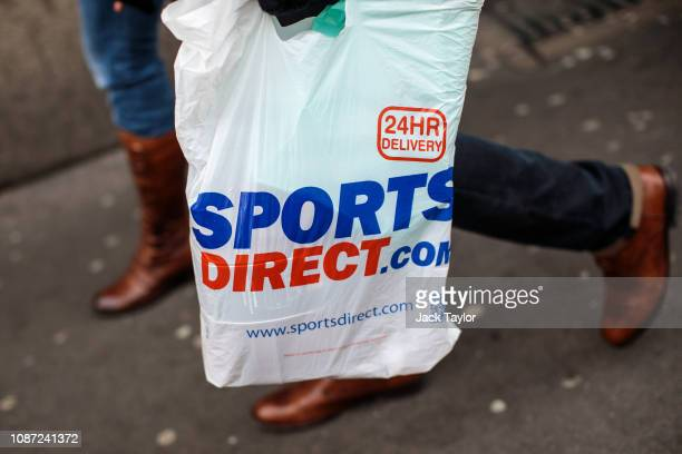 A plastic Sports Direct bag is carried by a shopper on December 27 2018 in London England England's current 5pence fee for plastic shopping bags...