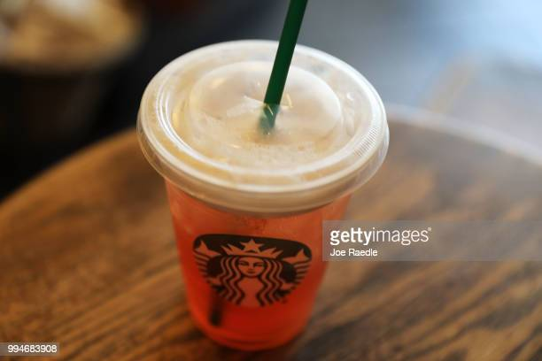 Plastic straw is seen in a Starbucks drink on July 9, 2018 in Miami, Florida. Starbucks announced today that it plans on phasing out all plastic...