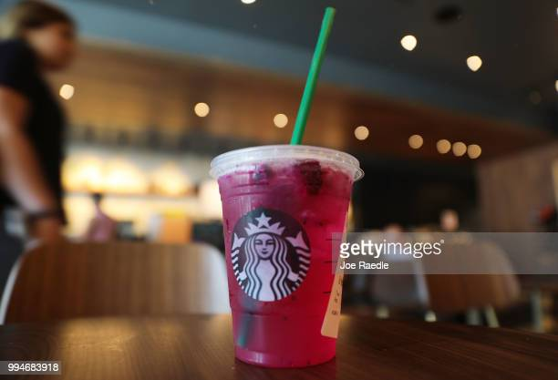 A plastic straw is seen in a Starbucks drink on July 9 2018 in Miami Florida Starbucks announced today that it plans on phasing out all plastic...