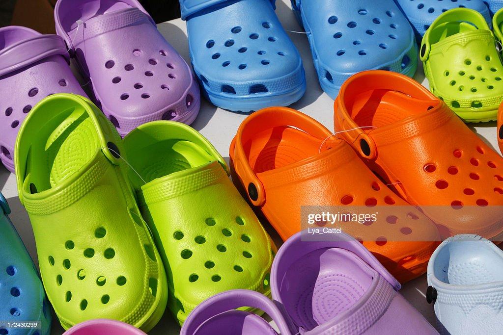 Plastic summer clogs : Stock Photo