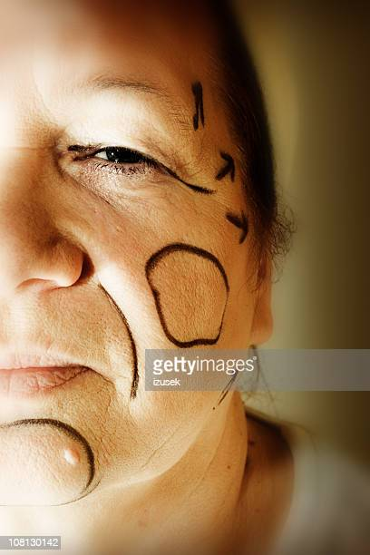 plastic surgery lines drawn on woman's face - izusek stock pictures, royalty-free photos & images