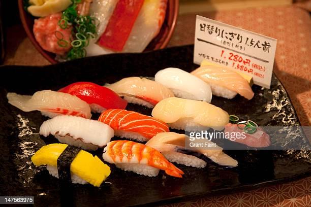 plastic sushi display .