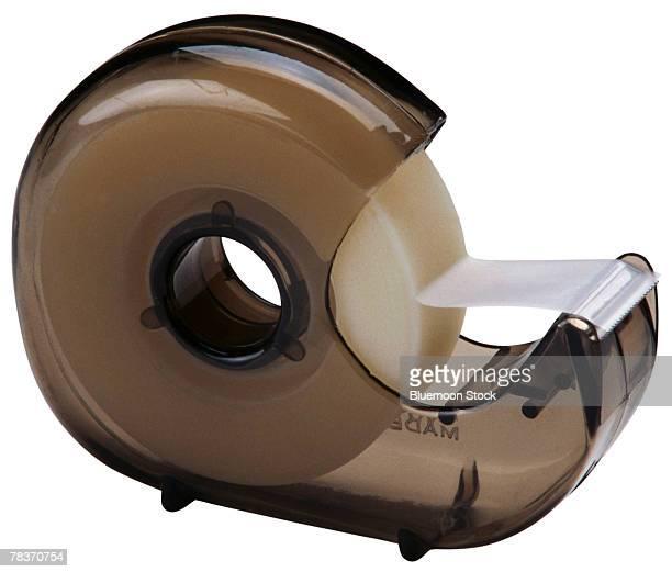 plastic tape dispenser - tape dispenser stock photos and pictures