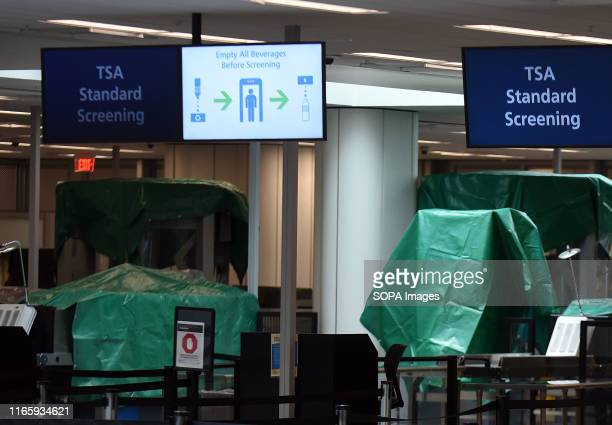 Plastic tarps are seen being used for covering the security screening equipment used by TSA at Orlando International Airport The airport was closed...