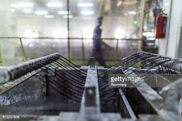 Plastic threads pass through an extruder that makes plastic pellets at Dainichi Color India Pvt's factory in the Rajasthan State Industrial...