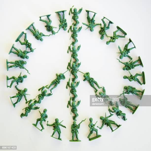 Plastic toy solders in shape of peace sign