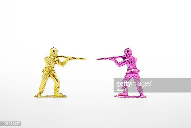 plastic toy soldiers facing one another - army soldier toy stock pictures, royalty-free photos & images