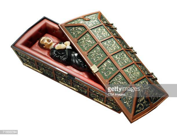plastic toy vampire in a coffin - coffin stock pictures, royalty-free photos & images