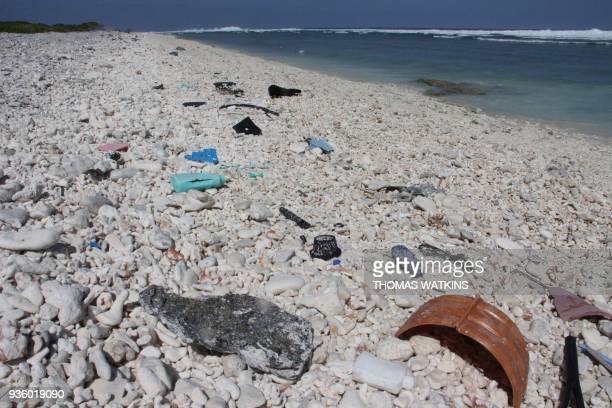 Plastic trash is seen strewn across a beach at Wake Island in the Pacific Ocean on February 2 2018 Residents here continually comb the beach for...