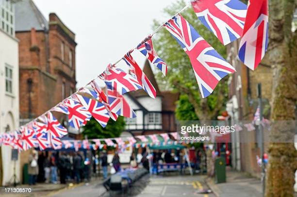 plastic union jack flag bunting - bunting stock pictures, royalty-free photos & images