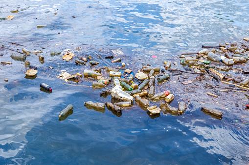 Plastic waste floating in the ocean 1022904148