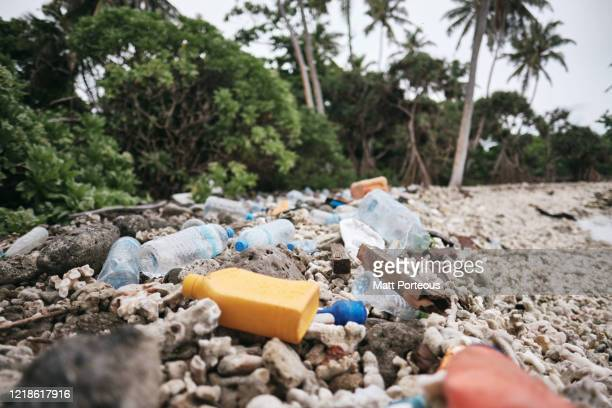 plastic waste on the beach - environmentalist stock pictures, royalty-free photos & images
