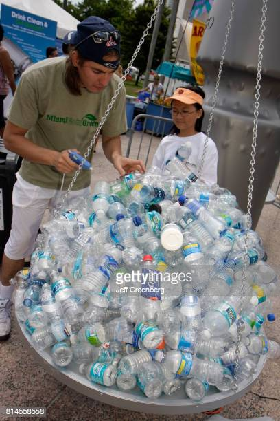 A plastic water bottles display at the Miami Goin' Green event