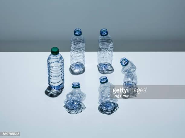 Plastic water bottles in various states of deformation