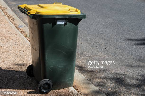 plastic wheeled recycling rubbish bin beside the road for rubbish collection - garbage bin stock pictures, royalty-free photos & images