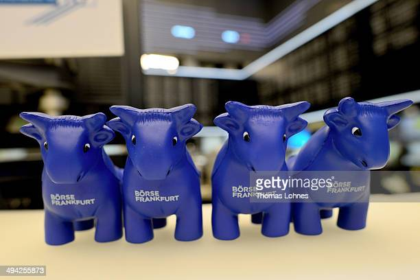 PlasticBulls are displayed at the Frankfurt Stock Exchange on May 28 2014 in Frankfurt/Main Germany The DAX is at a high level just below the 10000...