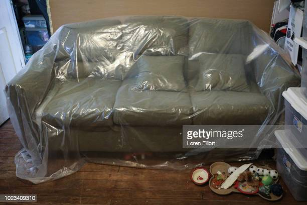 A plasticcovered couch inside a home badly damaged by Hurricane Harvey is pictured in the Kashmere Gardens neighborhood on August 25 2018 in Houston...