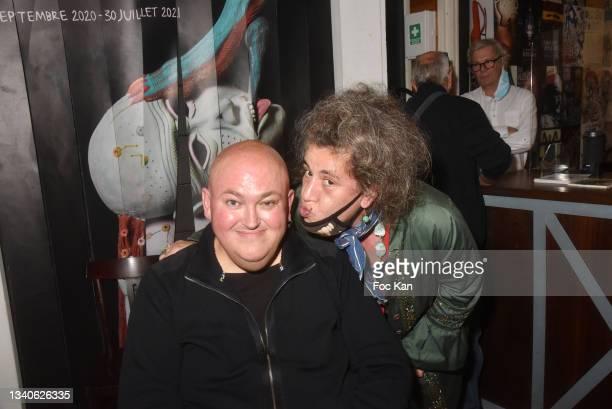 "Plastician/cartoonist Stephane Blanquet and a guest attend ""Le Cinema De Benoit Delepine Et Gustave Kervern"" Book Signing Party At Halle Saint Pierre..."