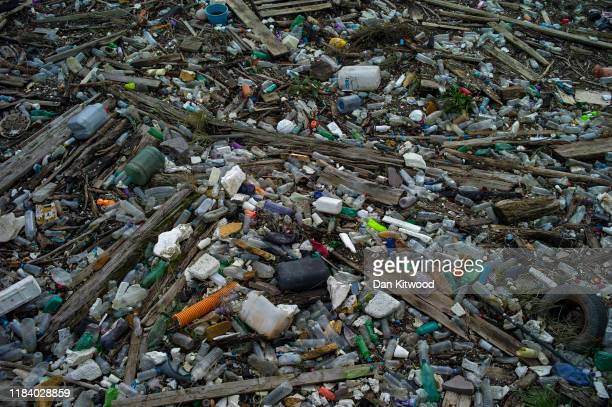 Plastics and other detritus line the shore of the Thames Estuary on October 28 2019 in Purfleet Essex Tons of plastic and other waste lines areas...