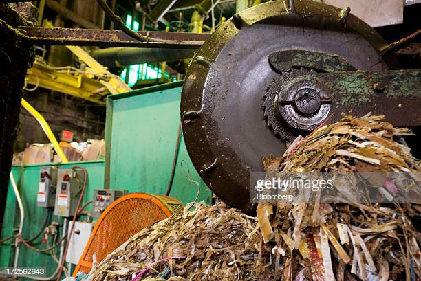 Plastics metal glass and other non paper materials are separated from cardboard and paper before being loaded into a hydro pulper machine inside the...