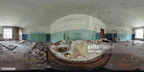 A plate bottles and a notebook lie on a table in an abandoned house on April 9 2016 in Zalissya Ukraine Zalissya once a village of several hundred...