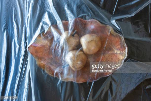 plate covered in plastic - plastic plate stock pictures, royalty-free photos & images