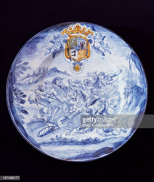 Plate decorated in blue with Hercules, the Amazons, and a coat of arms, ceramic, Savona manufacture, Liguria. Italy, 17th century. Milan, Castello...
