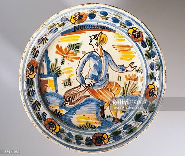 Plate decorated with a hunt, symbol of the month of November, piece taken from the Months series, maiolica factory in Bassano del Grappa, Veneto....