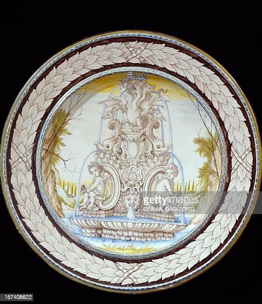 Plate decorated with baroque fountain milkcoloured maiolica Angarano manufacture Veneto Italy 17th century Milan Castello Sforzesco Civiche Raccolte...