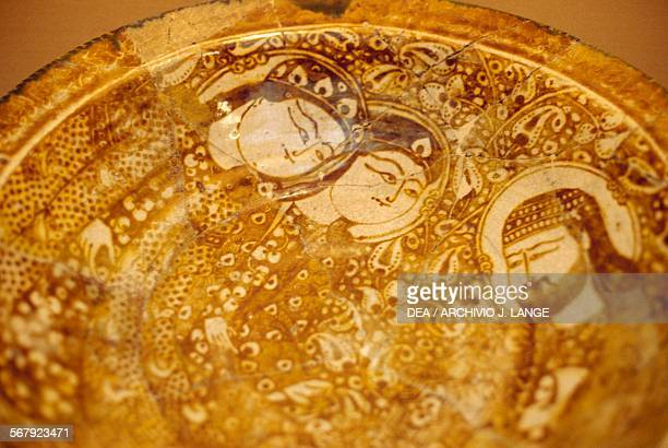 Plate decorated with male and female faces from Kashan Iran 13th century Teheran Glassware and Ceramic Museum of Iran