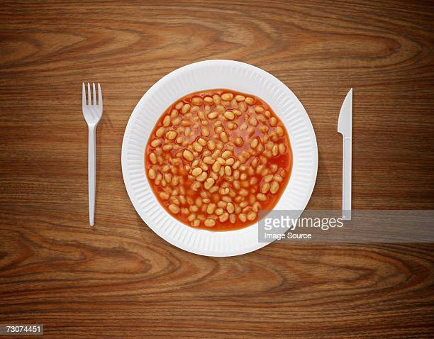 plate full of beans - paper plate stock photos and pictures