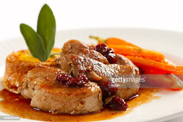 plate full of pork loin medallions and carrots - medallion stock photos and pictures